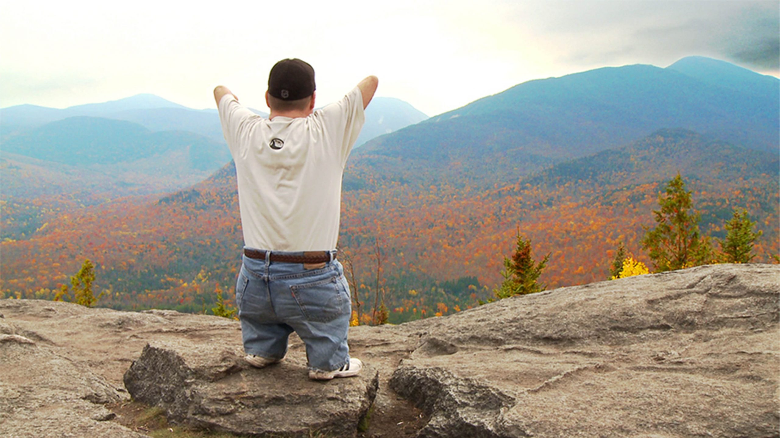 John Robinson on top of mountain